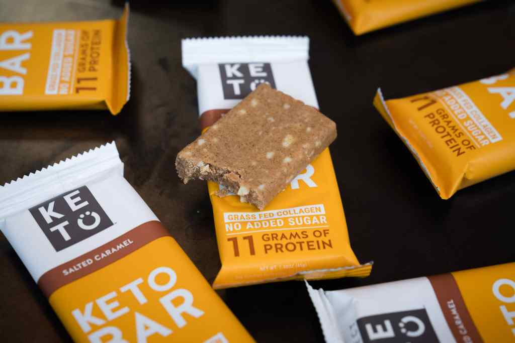 opened keto bar with a bite taken from it