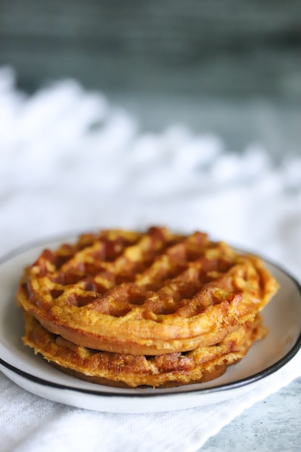 two plain keto pumpkin chaffles sitting on a plate