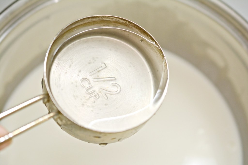 adding water into a stove top pan