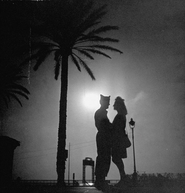 An American GI And His French Girlfriend Holding One Another While On A Date, 1940s