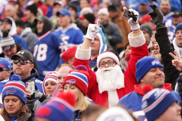 ORCHARD PARK, NY - DECEMBER 06:  A fan dressed as Santa Claus cheers during the first half against the Houston Texans at Ralph Wilson Stadium on December 6, 2015 in Orchard Park, New York.  (Photo by Brett Carlsen/Getty Images)