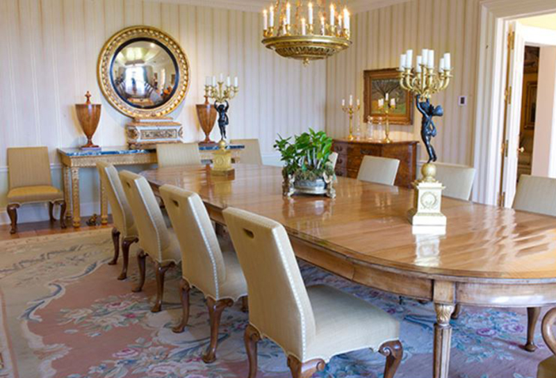 Oprah's dining room has a table that seats up to ten people.