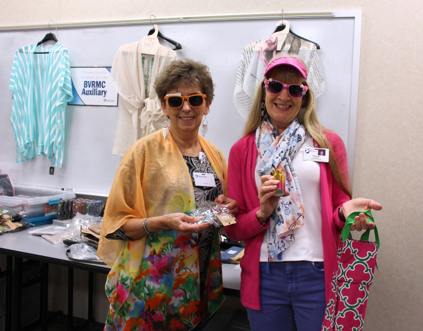 Two Auxiliary Members showing Jewelry Fair items.