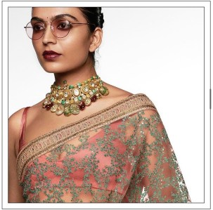 partially sequined coral and turquoise sabyasachi saree