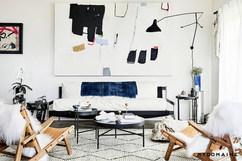 accessorized room with furniture, art, and books
