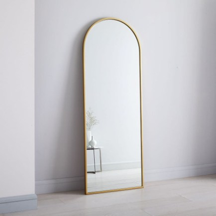 This west elm large, gold framed floor length mirror with a rounded top is chic and a huge statement piece that doesn't require much effort or money. An awesome DIY hack! easy diy home decor ideas