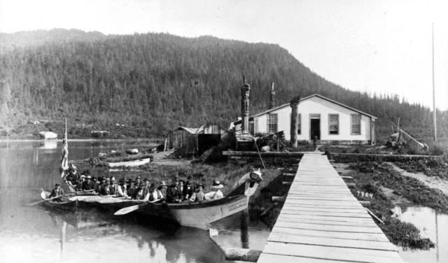 Chief Shake's house canoe with Indian Funeral at Ft Wrangel, Alaska, circa 1890.