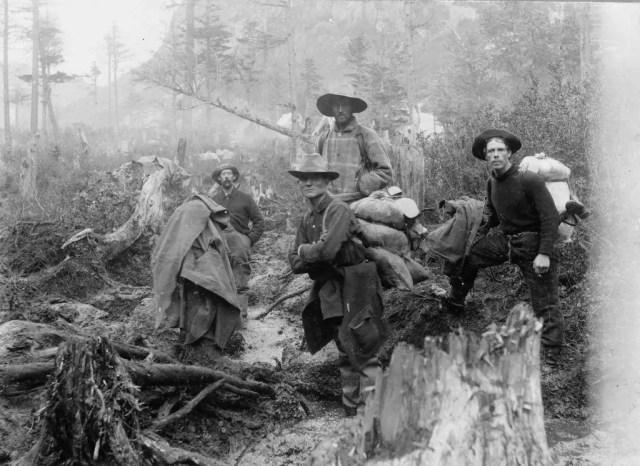 Ffour prospectors posed on a trail, Alaska, 1897.