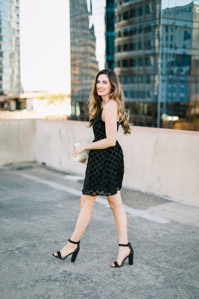 Velvet Polka Dot Party Dress with a faux fur clutch and black heeled sandals, By, Hilary Rose in Austin, TX