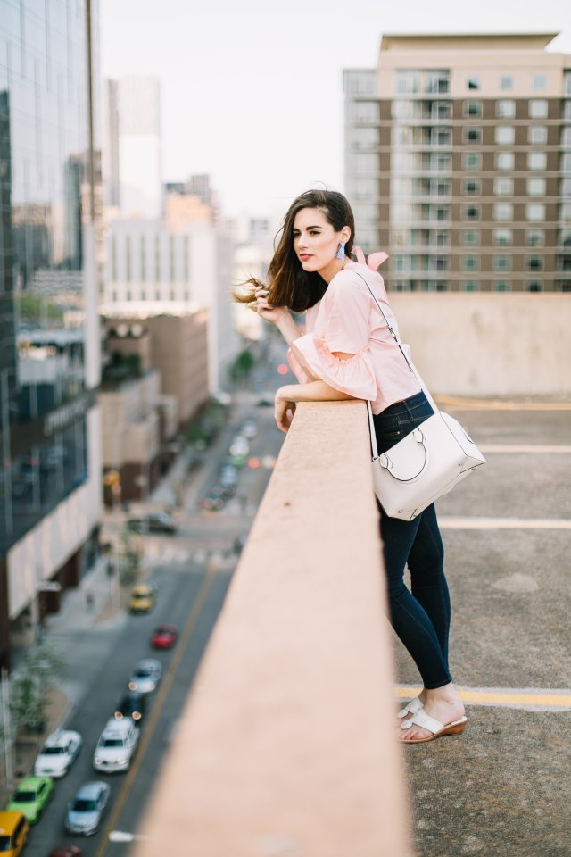 Pink bell sleeved blouse with a lizard tote bag by Henri Bendel, skinny jeans, tassel earrings, and Jack Rogers Sandals | By, Hilary Rose, Austin Blogger