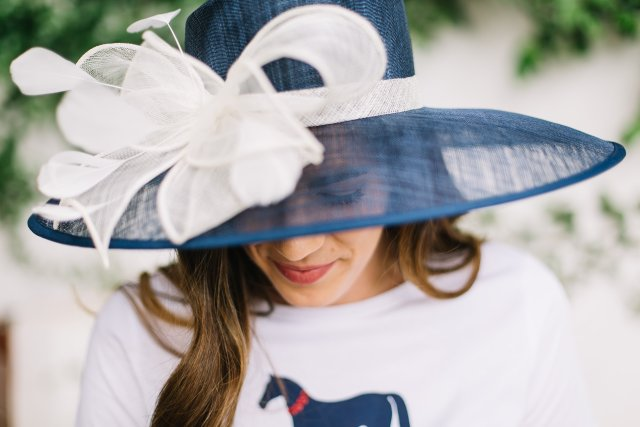 Derby Day Stylewith Draper James | Kentucky Derby Style | Polo Match | Large sunhat with graphic tee, navy skirt, and jack rogers sandals in Austin, TX