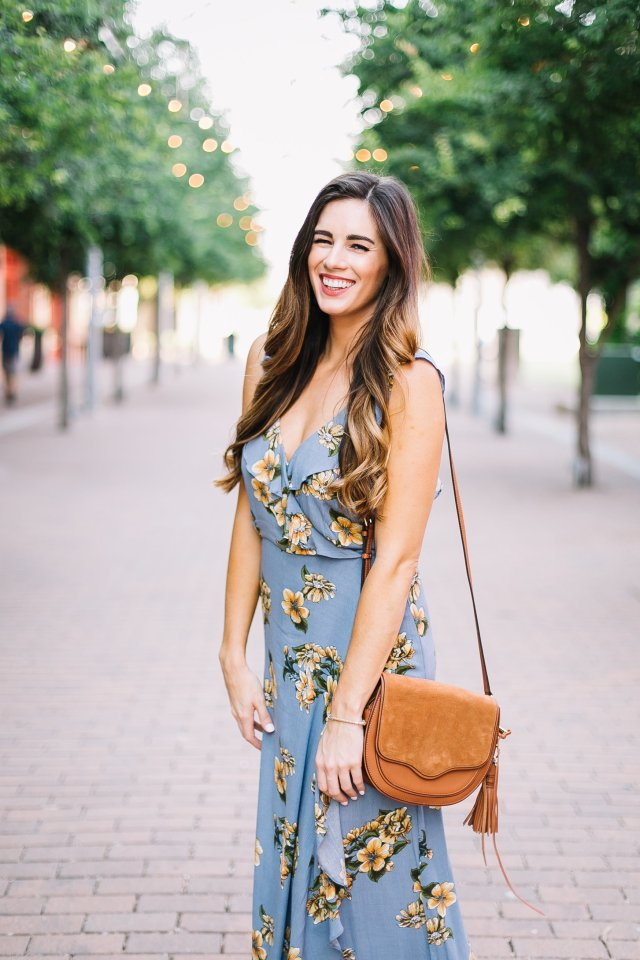 floral maxi dress with ruffle details, morning lavender boutique, rebecca minkoff suki cross body bag blue drop ball earrings frye slide sandals, summer outfit ideas