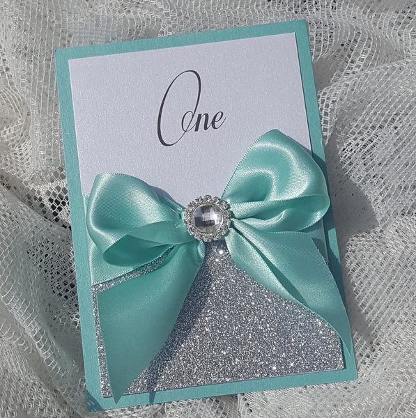 bows and bling aqua and silver table number
