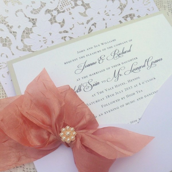 bows and bling laser cut pocket with rose gold ribbon