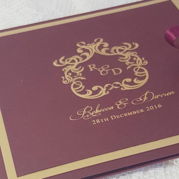 burgundy and gold monogram invitation