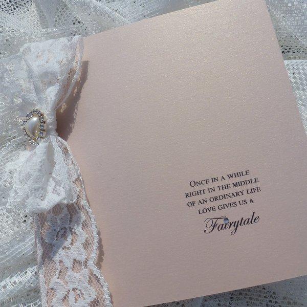 folded invitation lace bow