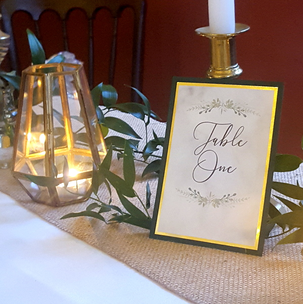 green and gold wedding table name