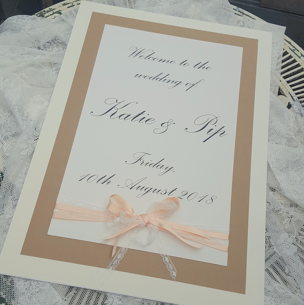 ivory and kraft wedding sign with peach ribbon and lace