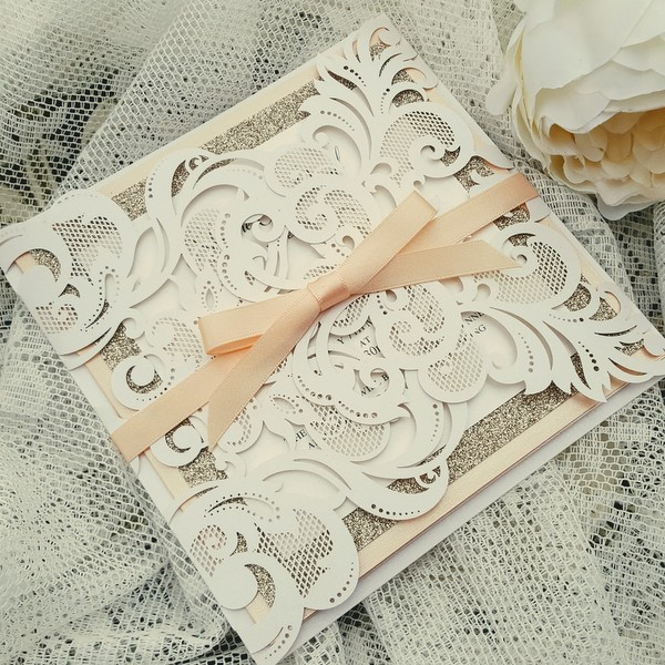 white, champagne and peach laser cut wedding invitation