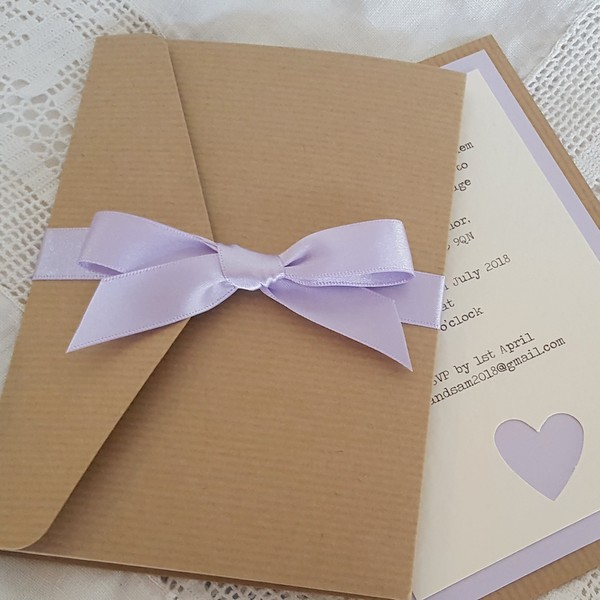 simple kraft pocketfold invitation with lilac ribbon