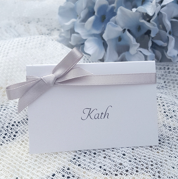 elegant white place card with silver grey ribbon