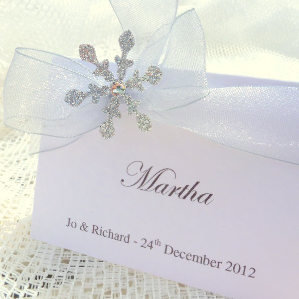 white and silver snowflake place cards