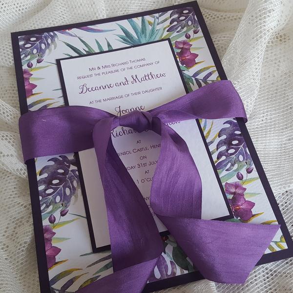 tropical purple wedding invitation with silk ribbon