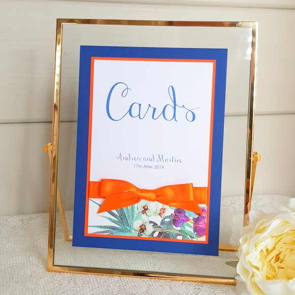 blue and orange wedding cards sign