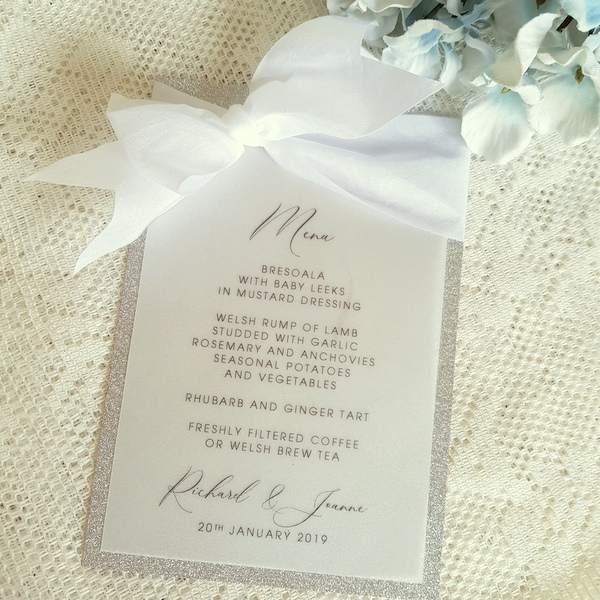 vellum and silver glitter menu with white silk ribbon