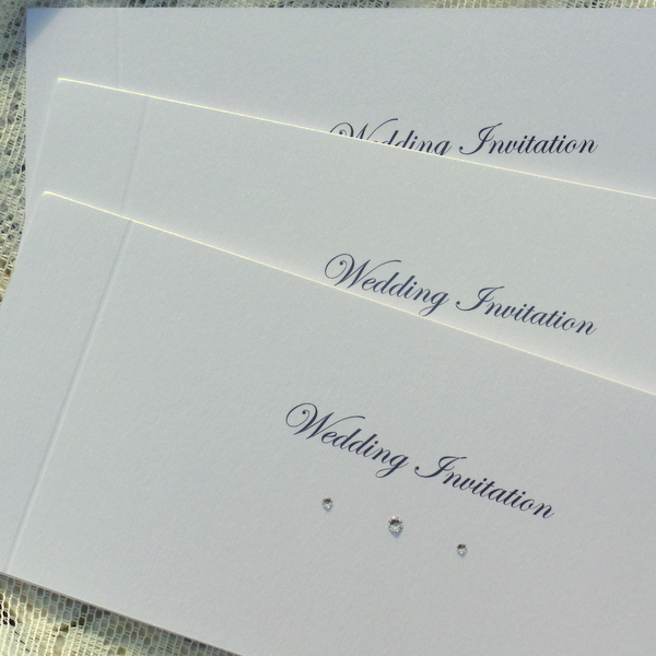 white sparkle cheque book invitations