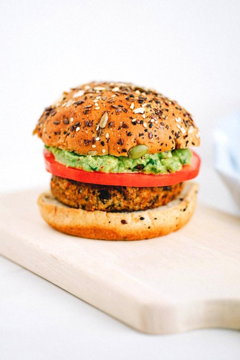 vegan burger on light wood board