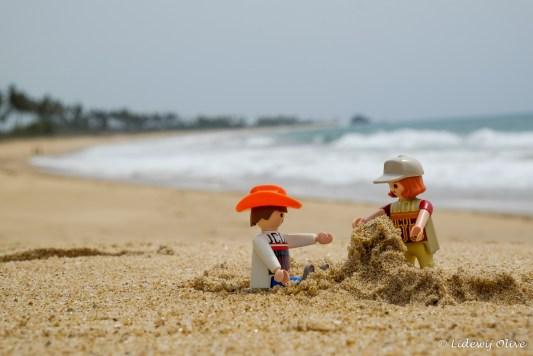 Travel companions building a sand castle