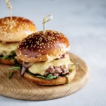 Homemade juicy burgers with beef, cheese and caramelized onions. Street food, fast food. Copyspace