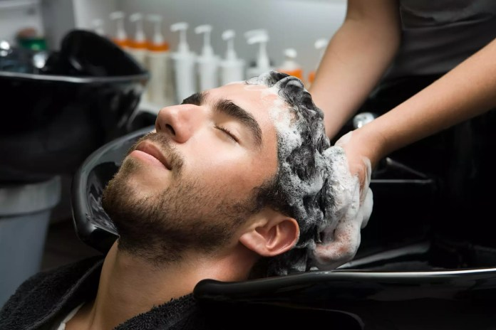 Man getting his hair washed at a salon