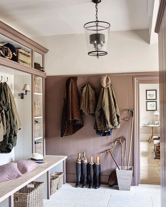 rustic hallway with dusty rose walls