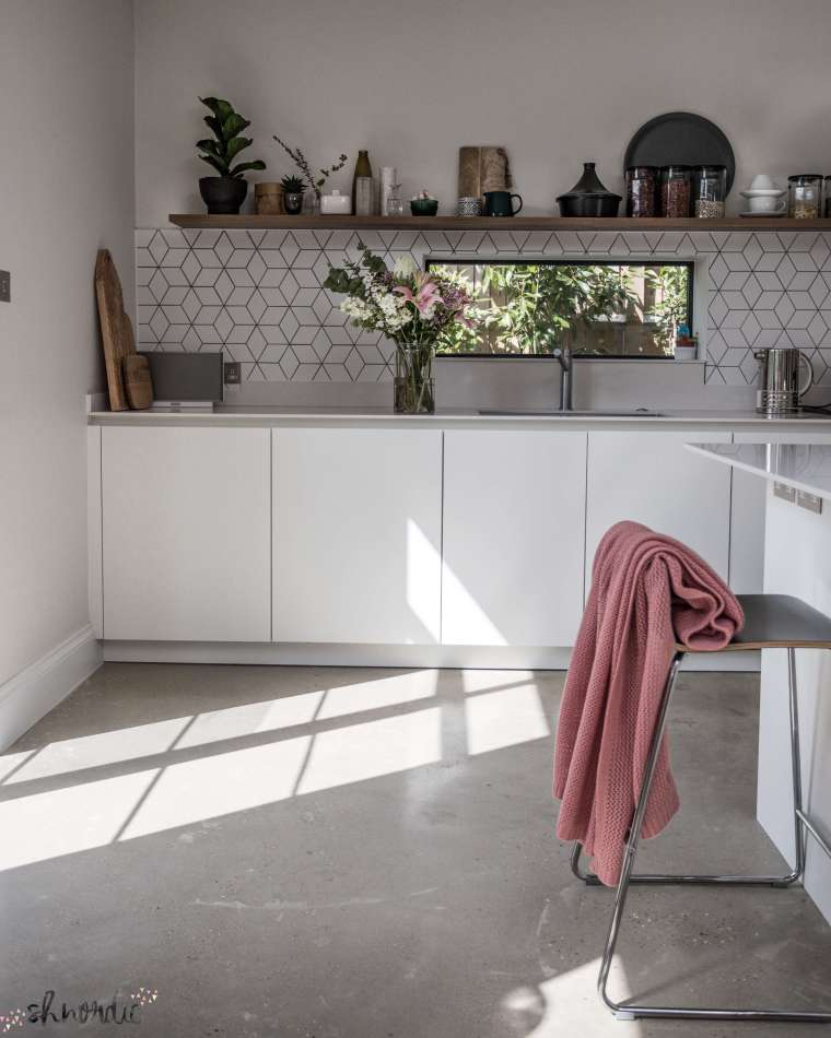 White kitchen with concrete floor