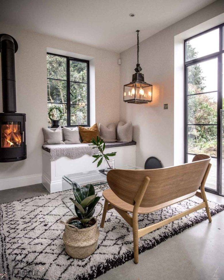 Kitchen seating corner, with Crittall windows and a log burner. It's compact in size but adds lots to the room.