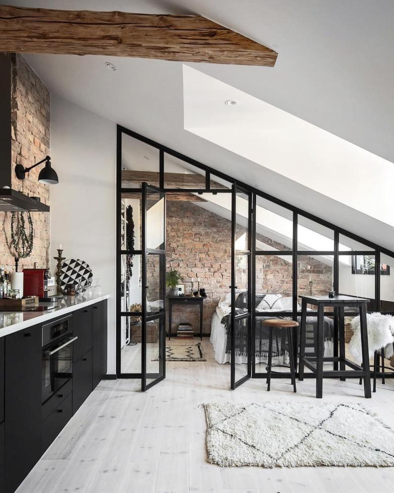 Industrial style internal glass wall with exposed brick