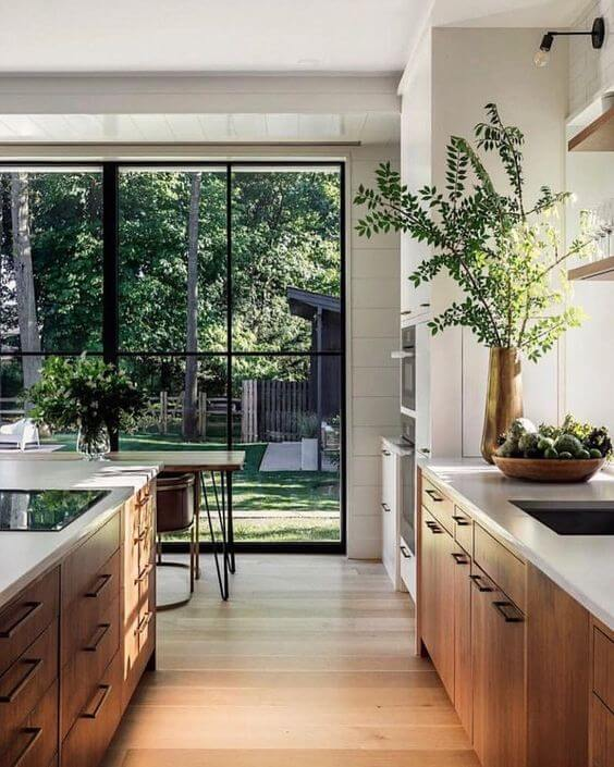 wooden kitchen and wall of glass