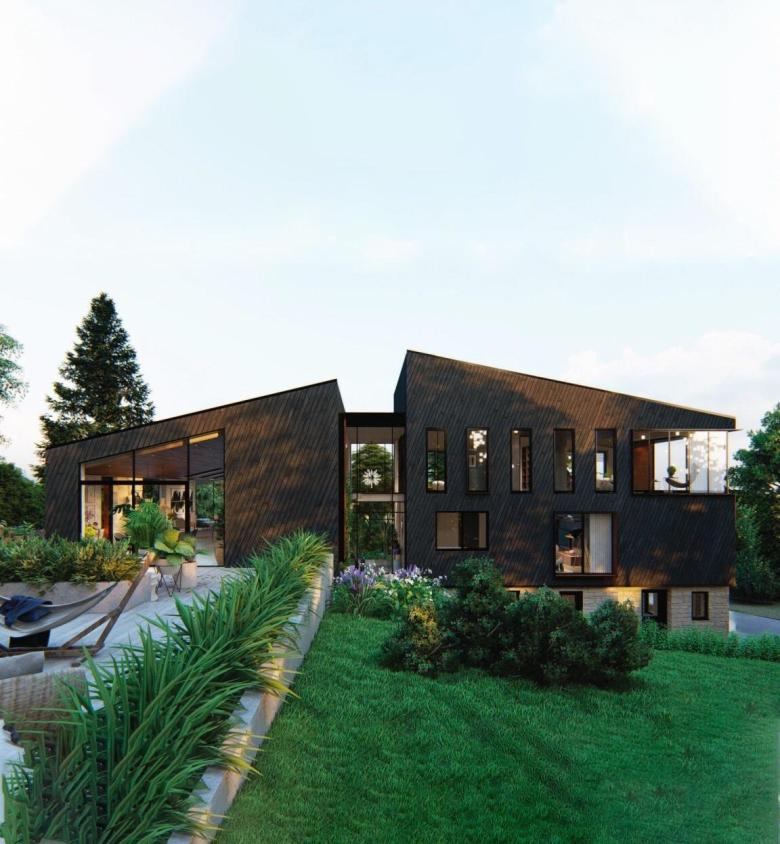 black cladded modern house with lots of glass