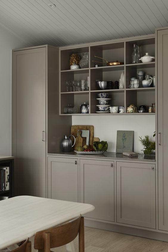 mid-tone kitchen with open shelving unit on the wall