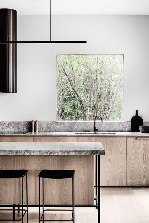 beautiful combination of oak, grey marble and big window make this kitchen spectacular