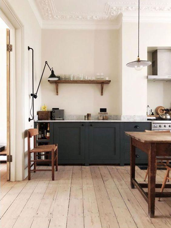 black kitchen units with light wooden floor