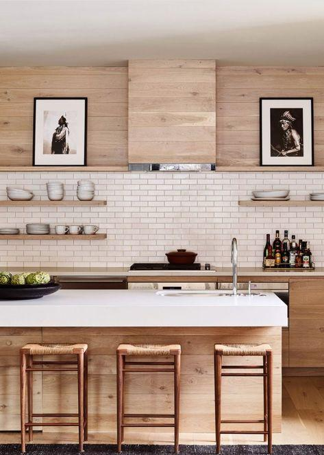 light wooden kitchen with slim white metro tiles