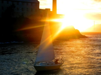 Sunburst sailboat over Alcatraz