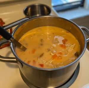 Tom Kha Gai Coconut Chicken Soup simmering