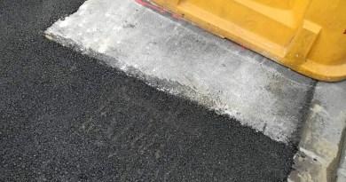 Bolzano, nuovo asfalto in via San Vigilio ma non sotto i bidoni
