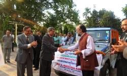 A Krishna Kumar, Managing Director SBI handing over the keys to Sanjoy Hazarika
