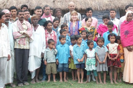 Ms. Carrie with villagers, students and UNICEF team in front of the Balichapori School