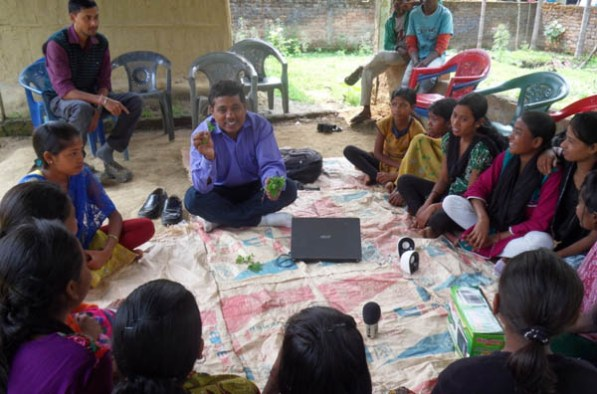 Manic Boruah, APM briefing about the importance of green vegetables to adolescent girls Boat babies